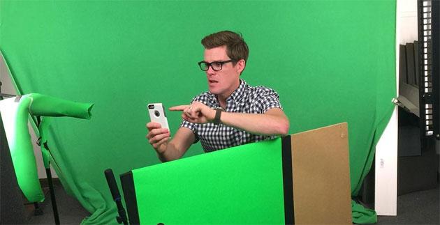 Joe Hanson where the magic happens, in the amusingly low-tech surroundings of a green screen.