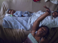 Kayden and Jayden Fleurimond, four months old, rest as their older sister Berlynda, 10, dances in the living room of their aunt's apartment. On Aug. 10, their mother Dacheca Fleurimond passed away at SUNY Downstate hospital after delivering her twin sons.