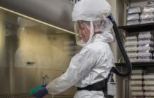CDC scientist wearing personal protective equipment.